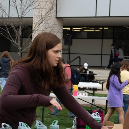 Students set up tables at the Earth day event.